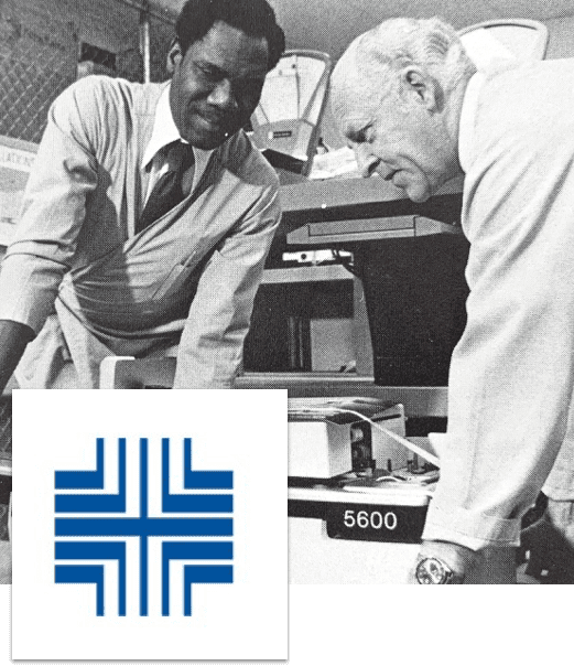 Image of 1971 Pitney Bowes logo update and employees working on 5600