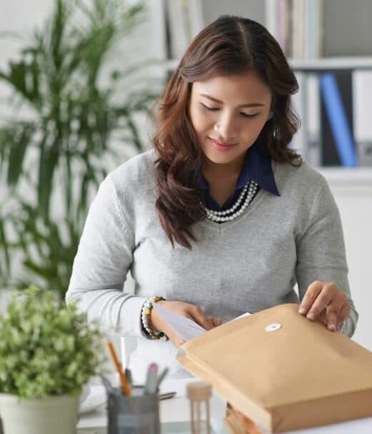 Image of woman packing a large envelope