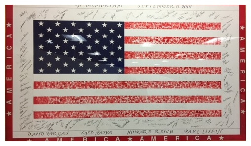 Image of an American flag with Pitney Bowes employees' signatures