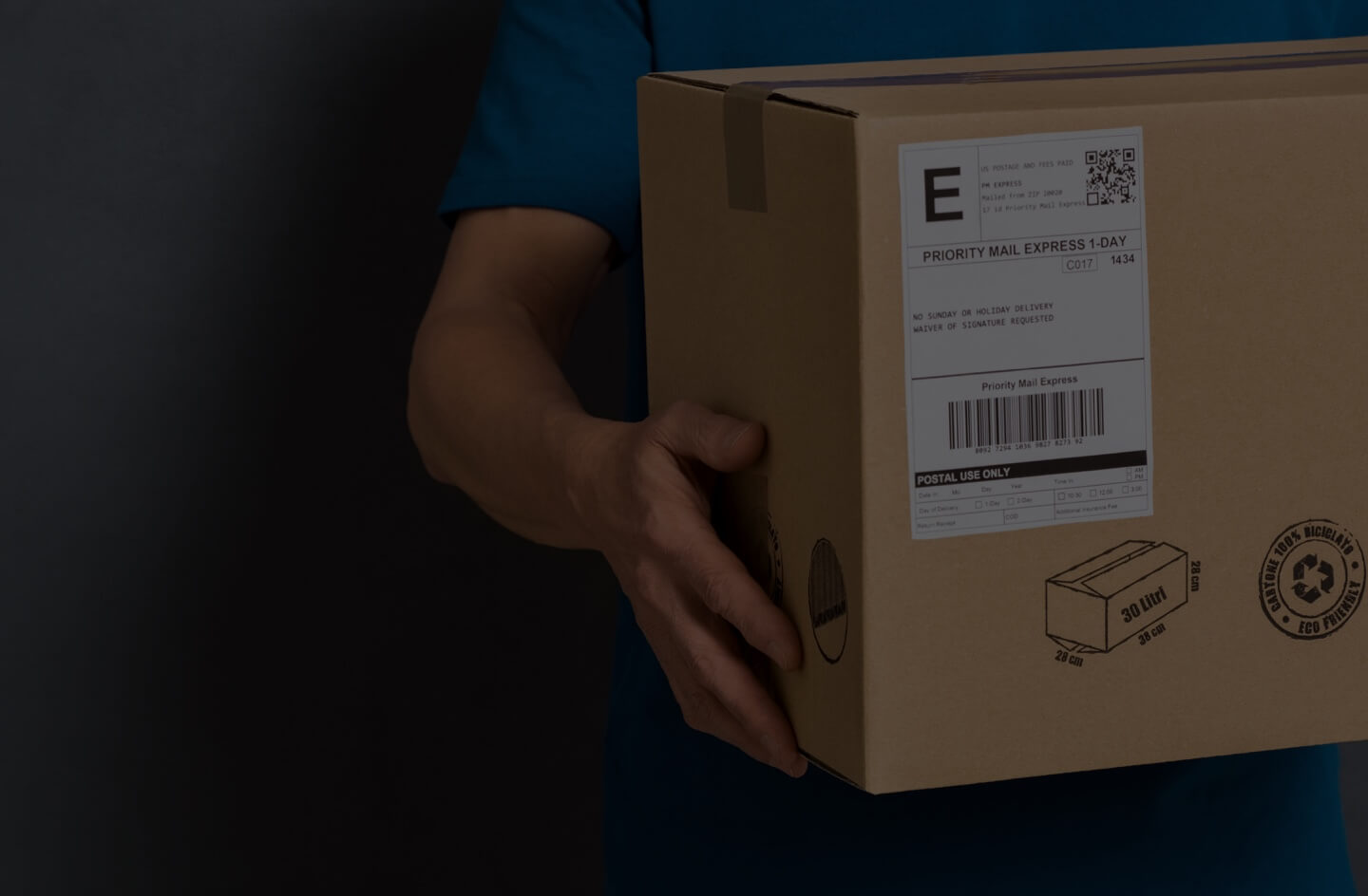Image of man holding package with shipping label