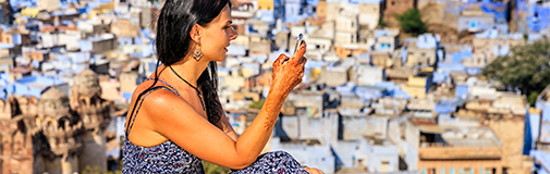 Indian woman looking at mobile phone