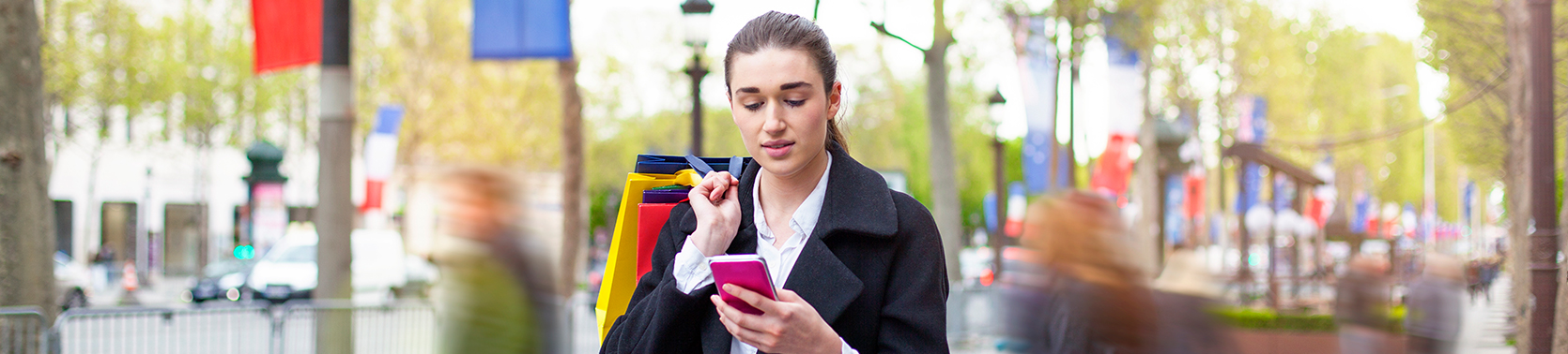 woman looking at her mobile phone