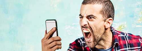 Man screaming at the cell phone