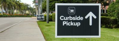 Curbside pickup banner showing on the sidewalk