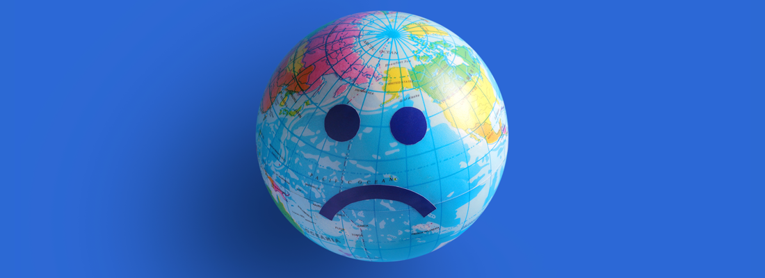 Globe with a sad face