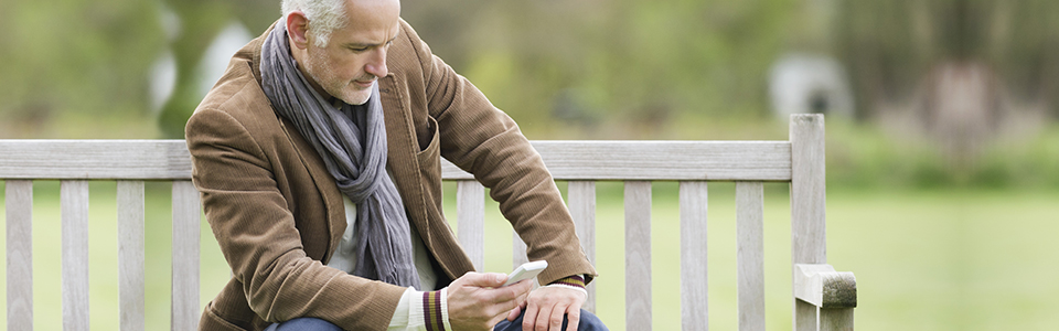 Man sitting on bench on mobile phone