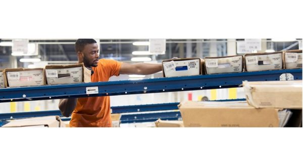 man sorting packages in a warehouse