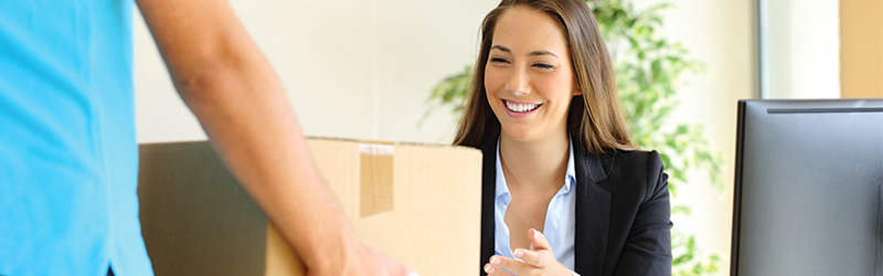 Woman smiling receiving package