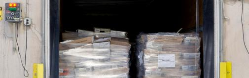 shrink wrapped pallets of mail