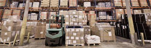 boxes in warehouse with forklift