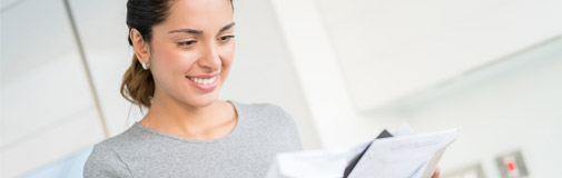 woman smiling at mail