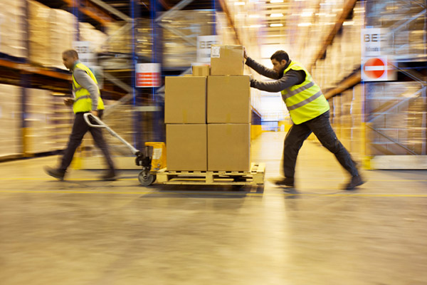 men moving a pallet in a warehouse