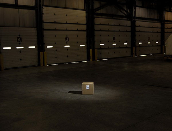 a single package in a dark warehouse