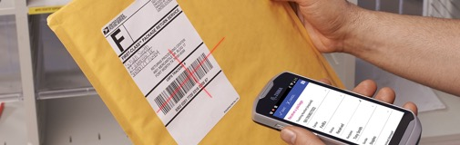 Man scanning an envelope using a cell phone