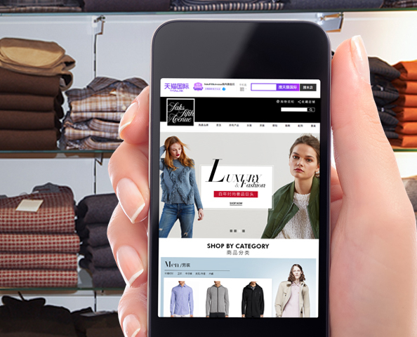 image of a marketplace on a cell phone, sweaters on shelves in background