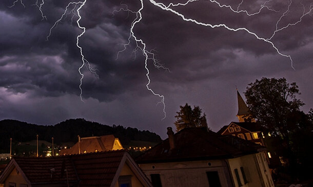 lightening striking over a town