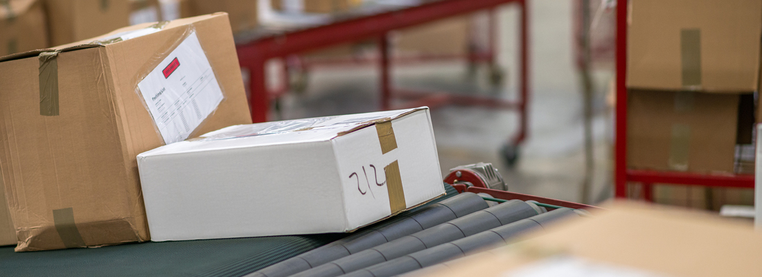 shipping packages on a conveyor belt