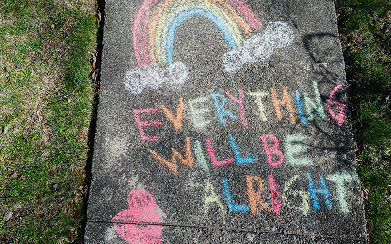 """Everything will be alright"" written in chalk on a sidewalk"
